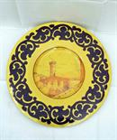 Italian School beginning of 20th century. A decorative polychrome ceramic plate depicting a `