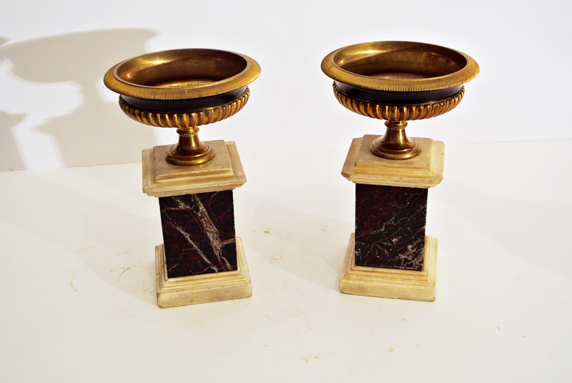 Genoese School 19th century. A fine pair of gilt and burnished bronze cups, with marble bases,
