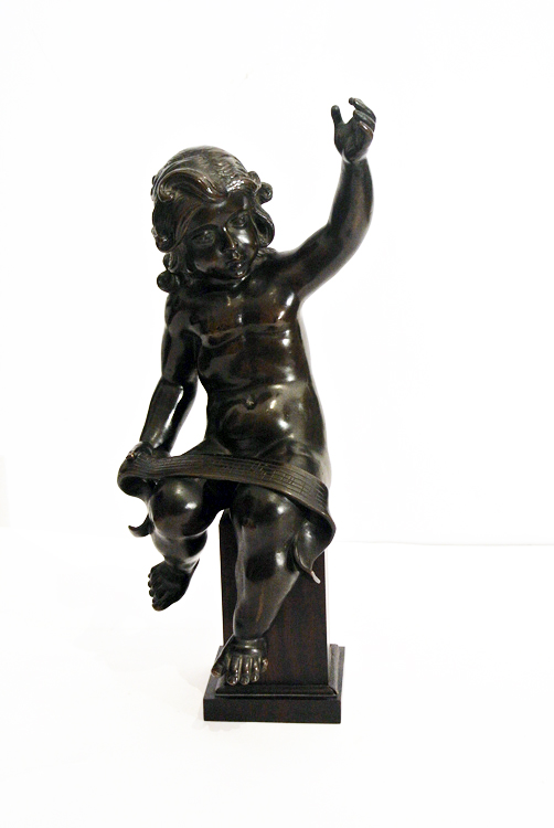 French School 19th century. A very beutiful burnished bronze sculpture depicting a `putto with