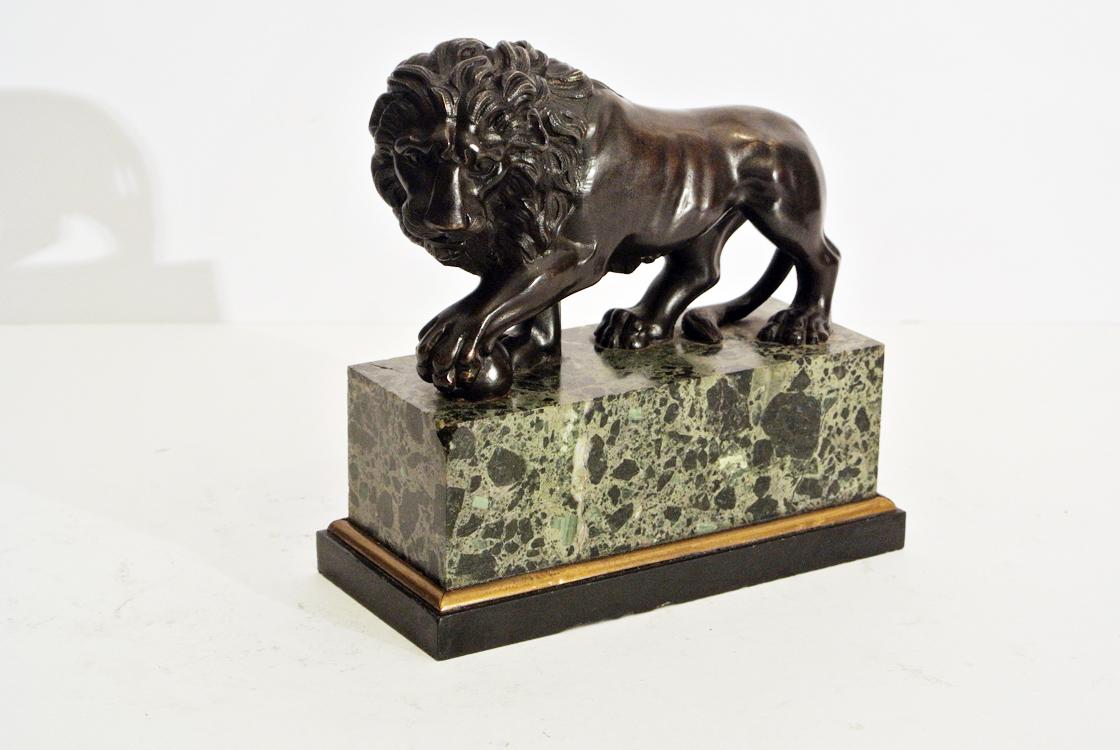 Italian School 19th century. A dark patina bronze sculpture depicting the `Farnese`s Lion`, the