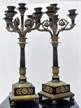 French School 19th century. A extremely decorative pair of candlesticks in burnished and gilded