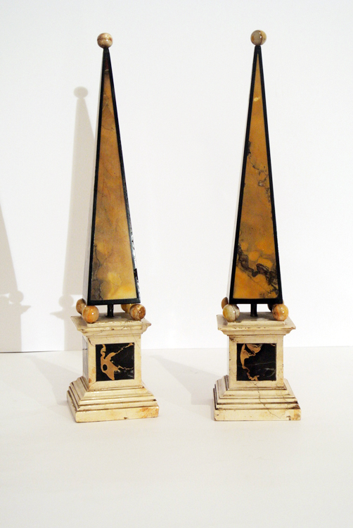 Italian School 19th century. A very fine pair of decorative obelisks, with black marble of