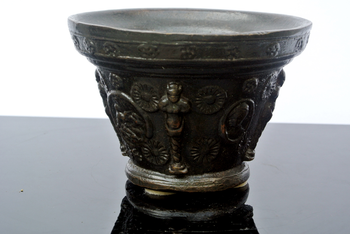 Germany School 16th century. A rare German bronze mortar decorated with flowers, medallions and