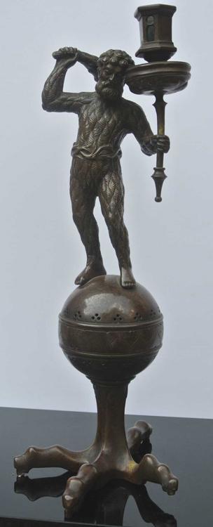 German School 19th century. A rare bronze sculpture candlestick representing Hercules wielding a