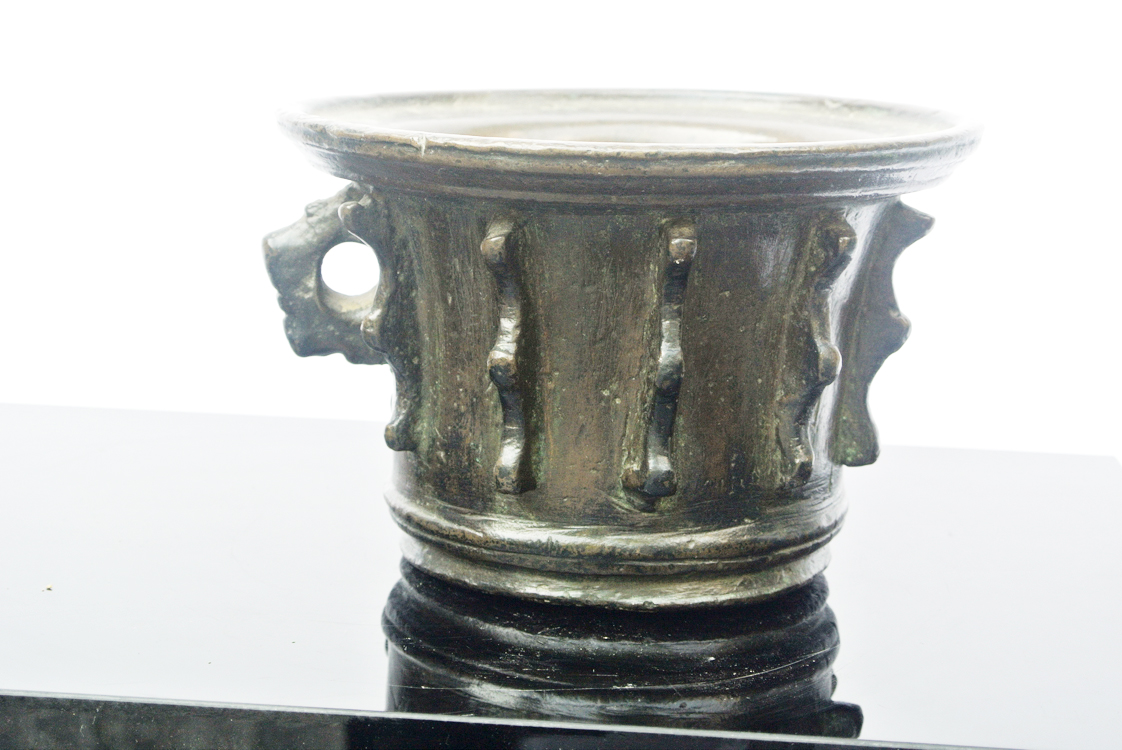 German School 16th century. A remarkable German bronze mortar with raised decorative elements,