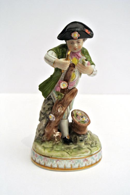 Meissen sculpture 19th century. A Meissen polychrome porcelain sculpture depicting a boy gathering