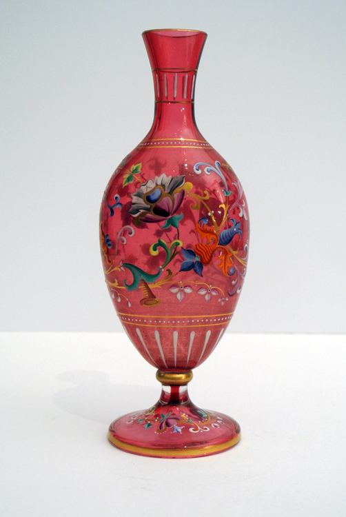 French School 19th century. A lovely little red glass paste vase, decorated with floral motifs,