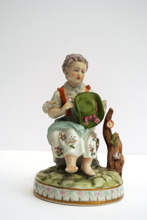 Meissen sculpture 19th century. A Meissen polychrome sculpture depicting a young girl sitting with