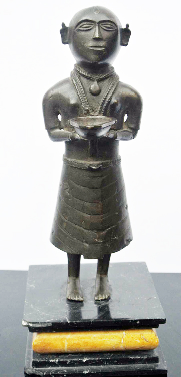 South America School 19th century. An outstanding bronze sculpture of a woman holding a bowl 19th