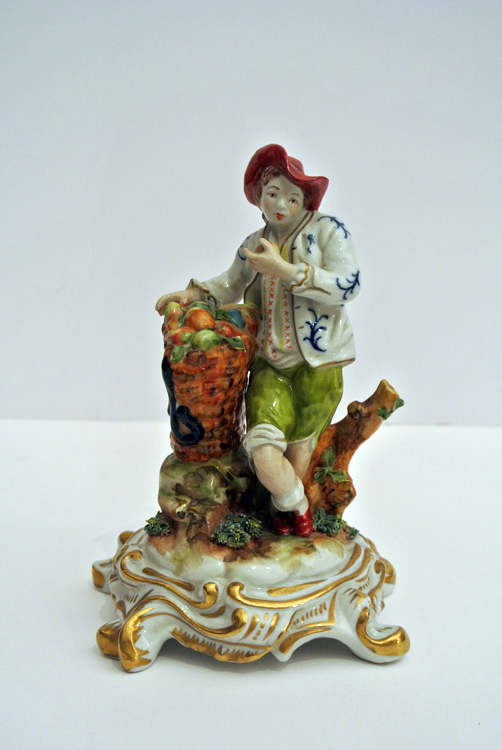 Capodimonte late 18th century. A lovely polychrome porcelain sculpture depicting a boy with a