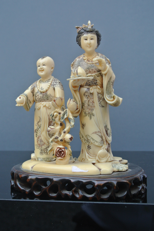 Japan School 19th century. A wonderful carved and polychrome ivory sculpture representing a woman