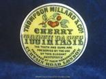 Old Pot Lid Thompson Millard Cherry Tooth Paste Yellow Background - Essentially perfect - 2.5
