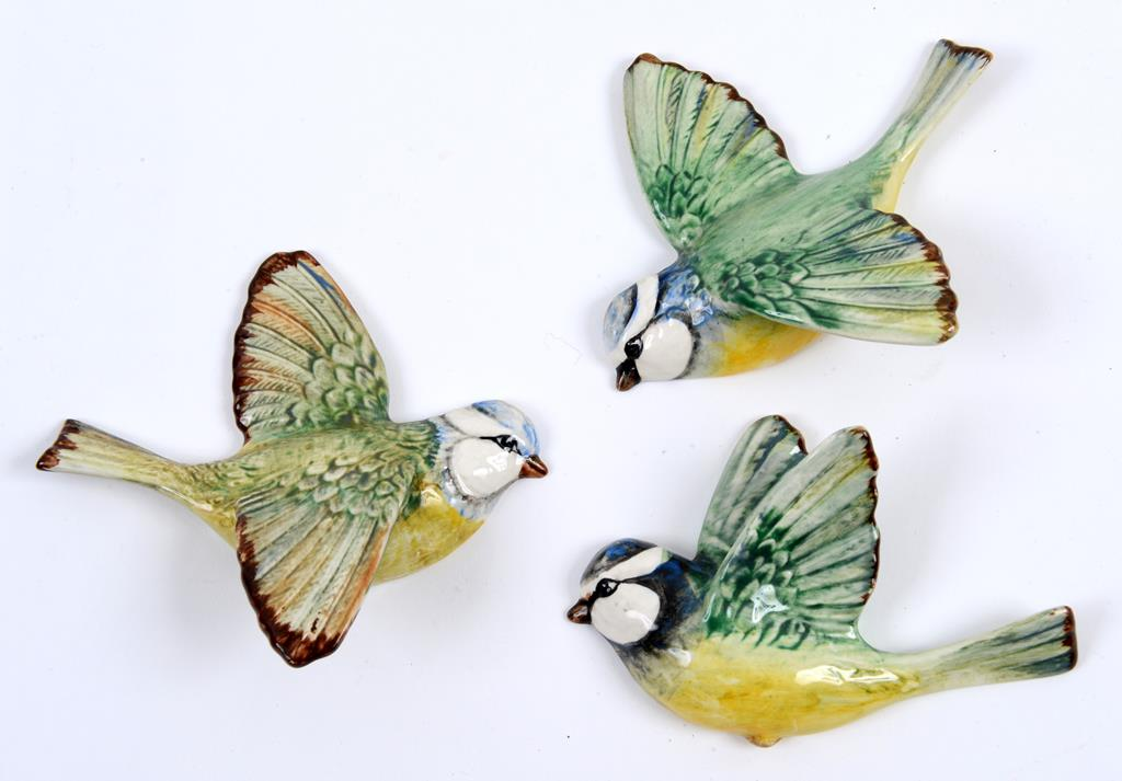 Lot 110 - A Beswick Blue Tit wall plaque, wings up, flying to the left, 707, and two others, 705 and 706,