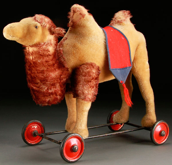 Lot 402 - A STEIFF CAMEL PULL TOY, MID 20TH CENTURY. With made in US-Zone Germany tag. Height 17.25 inches (