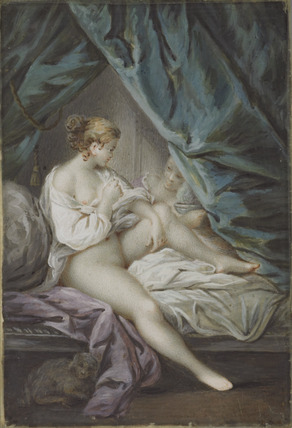 A nude woman on her bed