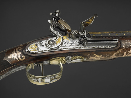 Detail from flint-lock rifle with ramrod