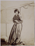 Jane Morris standing in a Marquee