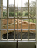 Looking through a window from the Master's Room towards the Exercise yard and brick-built latrines