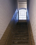 The inmates Stairs, looking up from the ground floor showing the window on the landing and the pair of hand rails