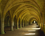 The magnificent West Range of the Cloisters at Fountains Abbey, which when occupied by monks would have been partitioned