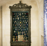 Renaissance cabinet under the stairs in the Tapestry Hall with a collection of mainly C19th crosses in gold, silver and gilt metal set with pastes and semi-precious stones
