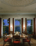 View towards Dining Room windows with mahogany dining table & chairs & part of plaster ceiling