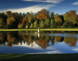 Late Autumn colours reflected in water at Studley Royal