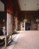 The Carved Room at Petworth House, showing the West and North walls, with an open door looking to the Red Room, recreating a view painted by C
