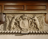 The Great Hall overmantel at Dunham Massey, is decorated with the coat of arms and boar supporters of the 2nd Earl of Warrington