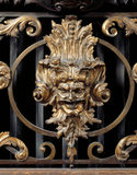 Detail of a satyr's head on a radiator cover in a window alcove of the Dining Room at Lyme Park
