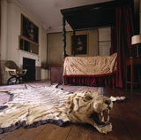 View of the Bedroom leading off from the Stone Gallery at Lacock Abbey, showing the four-poster bed and tiger skin rug