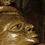 An African carved wooden mask , part of the Charles Wade collection in Seraphim at Snowshill Manor, Gloucestershire