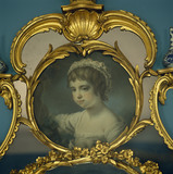 Part of the gilt overmantel above the chimneypiece designed by John Linnell in Mrs Child's Dressing Room at Osterley Park, the portrait is thought to be of Sarah Anne Child born in 1764