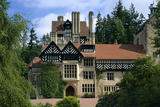 Close view facing entrance front of Cragside and showing building on the west front with detail of the tower and the sequence of buildings in front of it and of half-timbering and stone windows