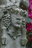 Detail of face on monkey pot pillar in the Italian Garden at Mount Stewart's Gardens