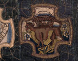 A motif of a creature from the Marian Needlework at Oxburgh Hall