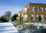The House at Hinton Ampner, viewed from the south east, with the surrounding lawn covered in snow