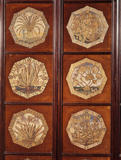 Close-up of six of the thirty two octagonal canvas-work panels displayed in the Drawing Room Passage