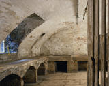The Cellar, room view of the cellar with built-in benches, recessed window and stone flagged floor
