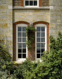 The Dining Room windows at Standen, on the east front, show Webb 's favourite round-headed sash frames