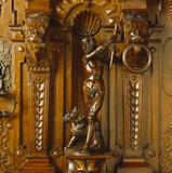 The walnut armoire dates from the 1830s in the State Bedroom at Penrhyn Castle