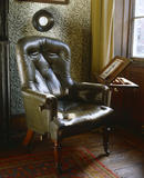 Carlyle's reading chair in the Drawing Room at Carlyle's House, 24 Cheyne Row, London, the home of writer Thomas Carlyle and his wife from 1834 to 1881