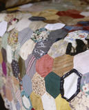 Detail of the patchwork bedspread in Mrs Carlyle's bedroom at at Carlyle's House, 24 Cheyne Row, London, the home of writer Thomas Carlyle and his wife from 1834 to 1881