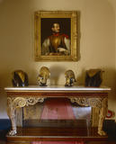 Marble-topped gilt pier table containing the armour of Charled Bedingfeld (b