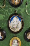 Miniatures against the green damask of the Green Closet at Ham House, Richmond-upon-Thames, central is Elizabeth I