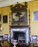 The Rococo chimneypiece and overmantel dating from c.1760 with painting in the Dining Room at Hanbury Hall.