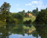 A view across the lake of the house at Chartwell, Kent, the family home of Sir Winston Churchill from 1922 until 1965