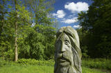 Carved wooden figure amongst the woodland at Ebworth near Painswick, Stroud, Gloucestershire