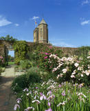 A view taken in the Rose Garden at Sissinghurst Castle Garden, with the Elizabethan Tower in view behind the walled garden