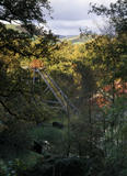 The Head Set at the Gold Mine viewed through the trees, with a glimpse of the distant hills beyond
